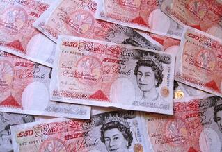 Pile of £50 notes