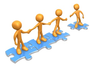 Team Illustration with four figures holding hands on jigsaw pieces