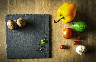 Selection of vegetables and a slate chopping board