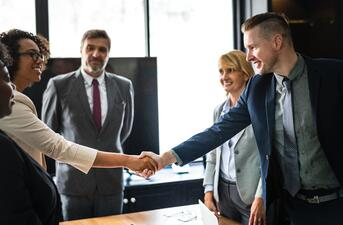 Business owner and investor shaking hands in a meeting